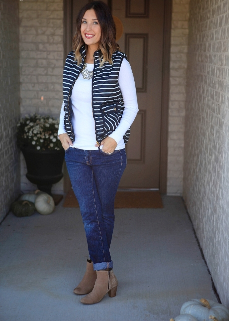 With white shirt, cuffed jeans and gray suede boots