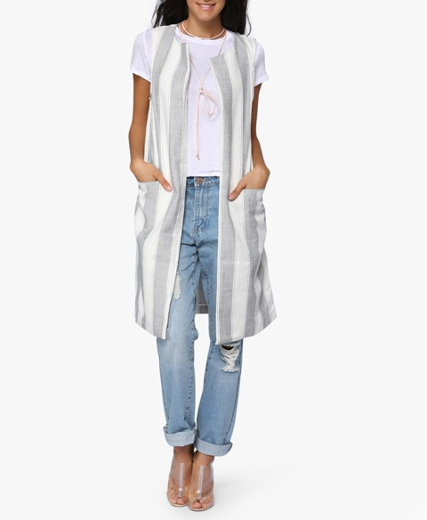 With white t-shirt, boyfriend jeans and lucite shoes