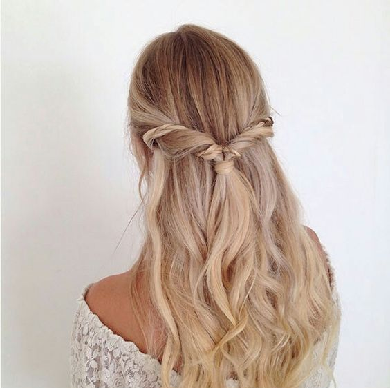 a twisted half updo with an accent braid and waves for a relaxed wedding