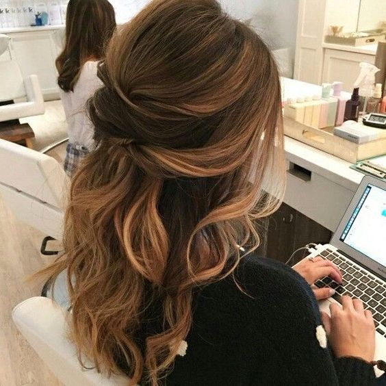a twisted wavy half updo is a chic idea to try and is great for both long and medium-length hair