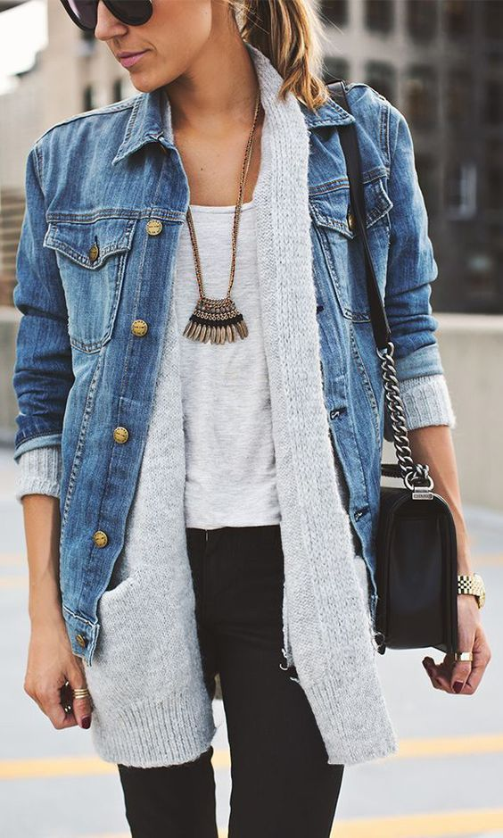 a grey tee, a grey cardigan, a denim jacket over it and a statement necklace