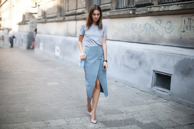 With pastel colored t-shirt, pumps and light blue bag