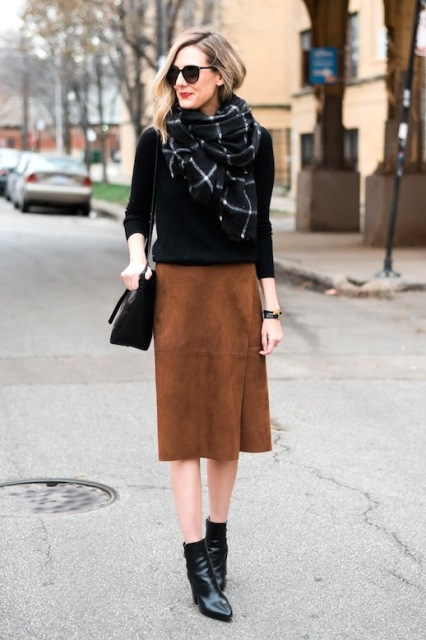 With black sweater, checked scarf, black bag and ankle boots