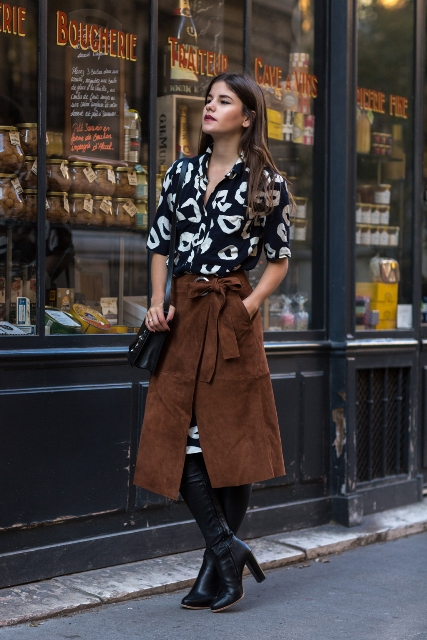 With printed dress, high boots and black bag