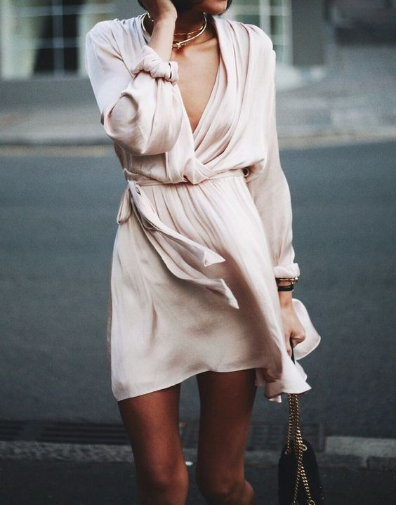 a blush chiffon dress with a plunging neckline, statement necklaces and a bag on chain is all you need