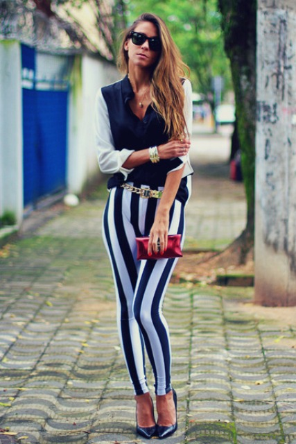 With blouse, pumps and mini clutch