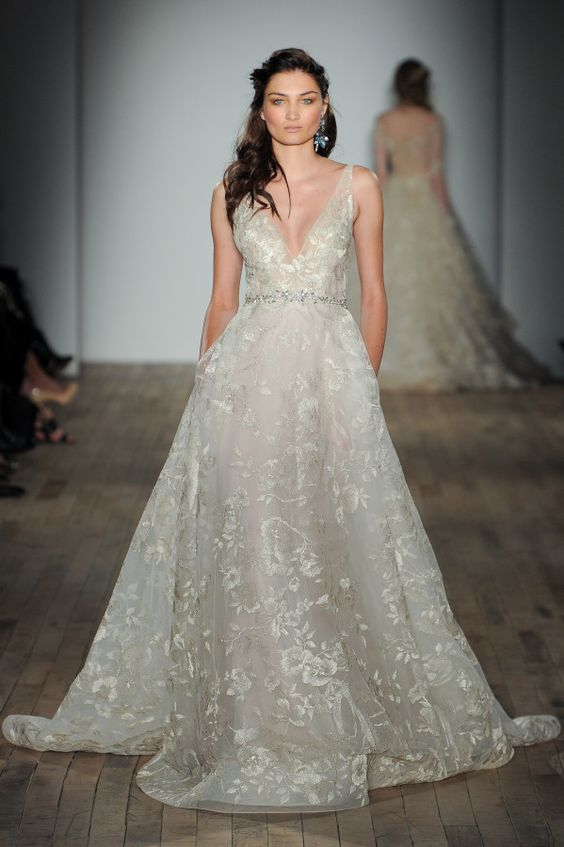 a sparkly floral print wedding gown with wide straps and a plunging neckline, an embellished belt by Lazaro