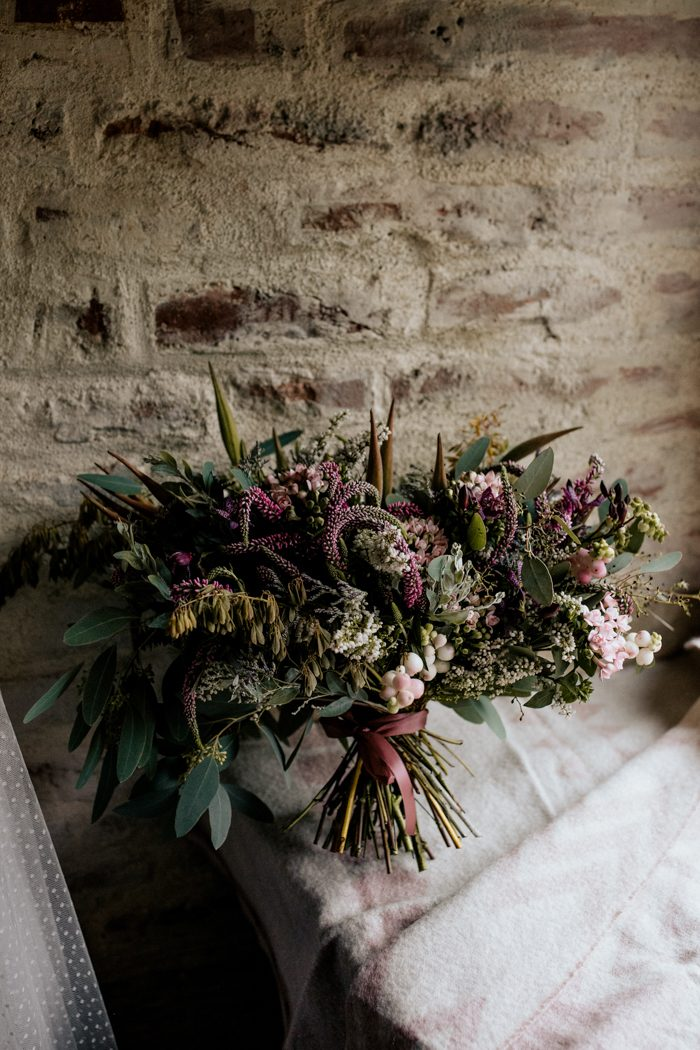 The lush wildflower bouquet looked crazy and very bold, it was perfectly matching the wedding theme
