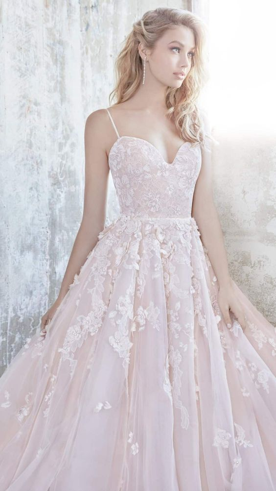 a spaghetti strap blush wedding ballgown with lace appliques by Hayley Paige