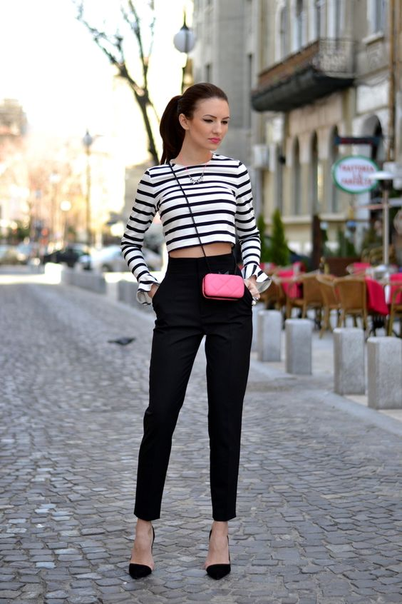 black high waisted pants, a striped shirt, black and nude shoes and a small pink bag