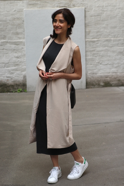 With black midi dress and white sneakers