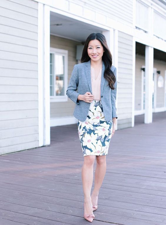 a floral print pencil skirt, a blush blouse with ruches, blush shoes, a grey jacket