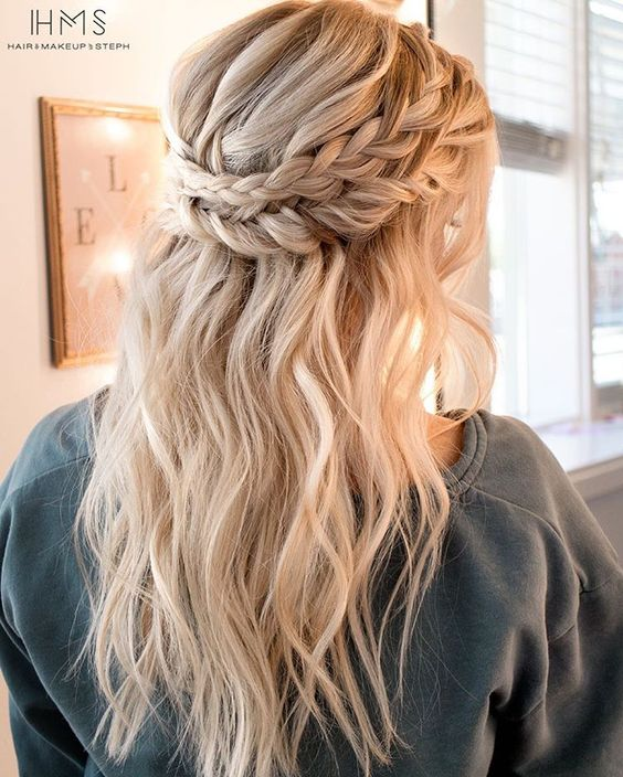 a double braid halo with wavy locks down for a romantic and relaxed or boho look