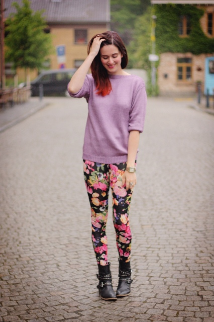 With pastel colored sweatshirt and black ankle boots