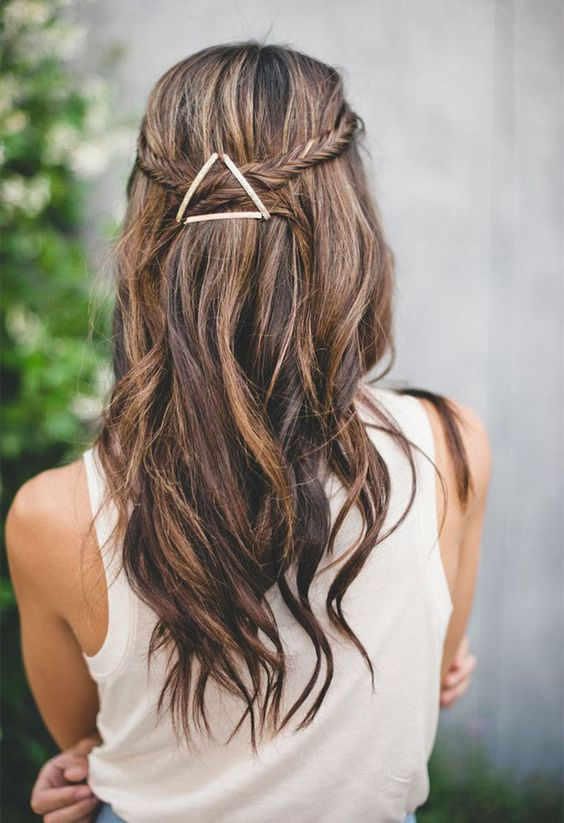 a fishtail braided half updo with waves and an eye-catchy geometric hairpiece that adds a boho feel