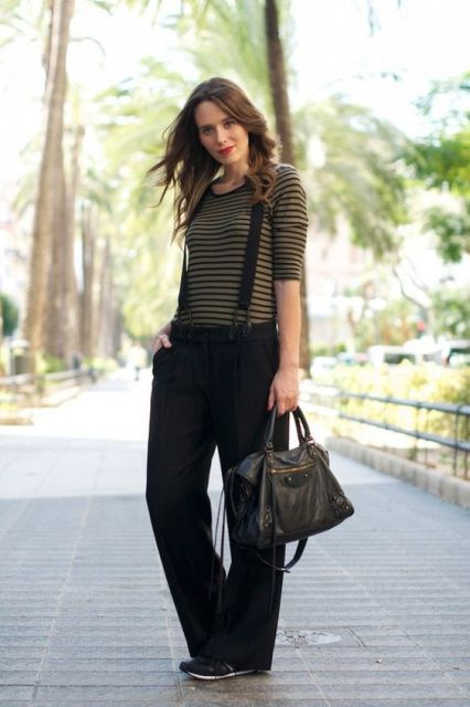 With striped shirt, sneakers and black leather bag