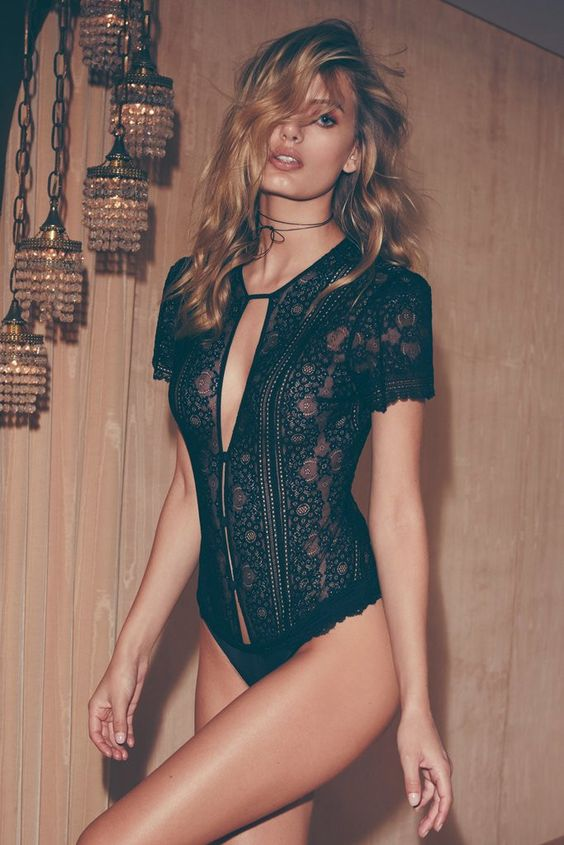 a black lace romper with short sleeves on buttons with cutouts