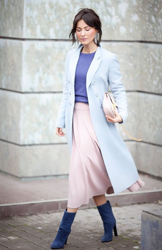 a powder blue coat, an ultra-violet top, a pink midi skirt, blue boots and a blush bag