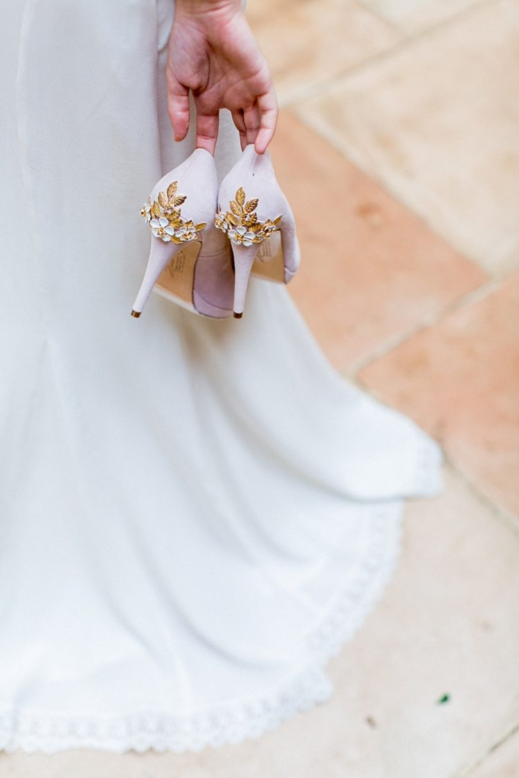 The blush shoes were also decorated with flowers