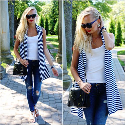 With white top, distressed jeans, white sandals and black small bag