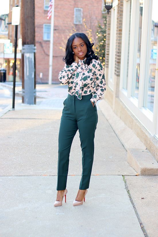emerald pants, a floral print blouse in the same shades and nude heels