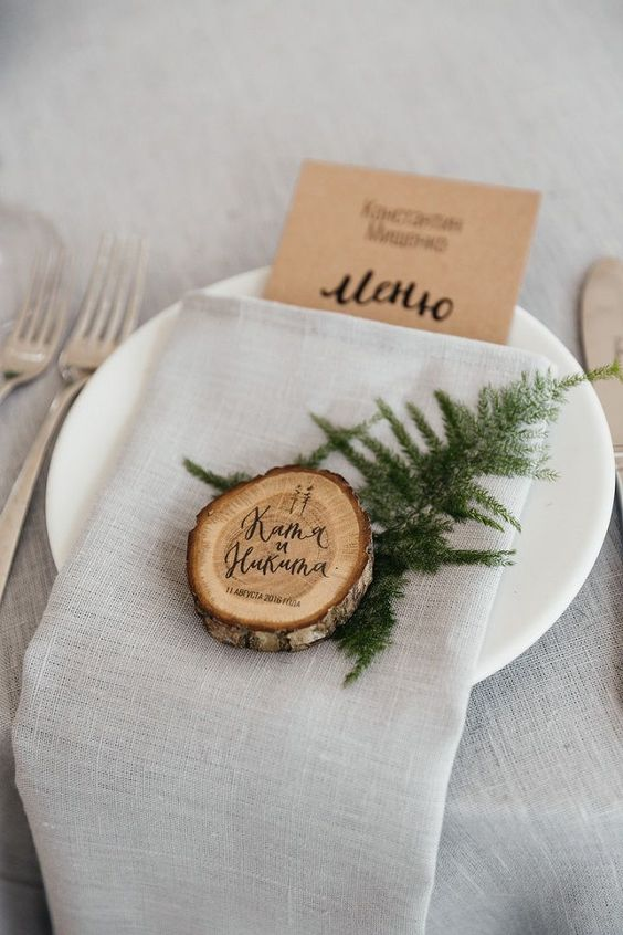 a wood slice coaster and place card in one is a simple and cute idea