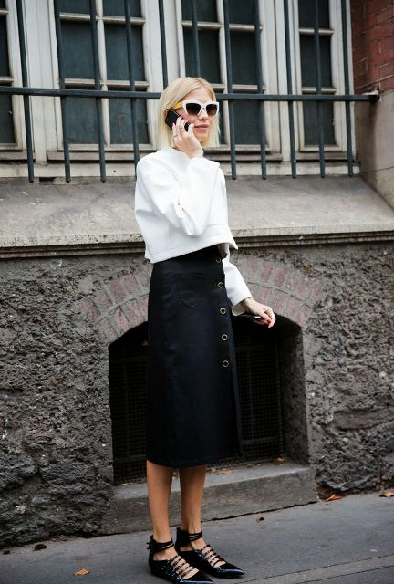 With white shirt and midi skirt
