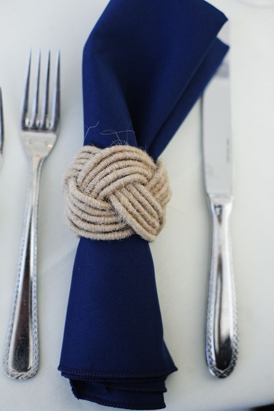 a navy napkin with a twine kot napkin ring for a nautical wedding