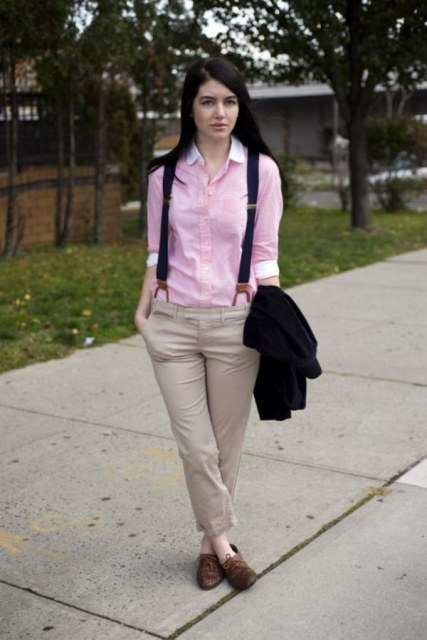 With pink shirt, brown flat boots and black jacket