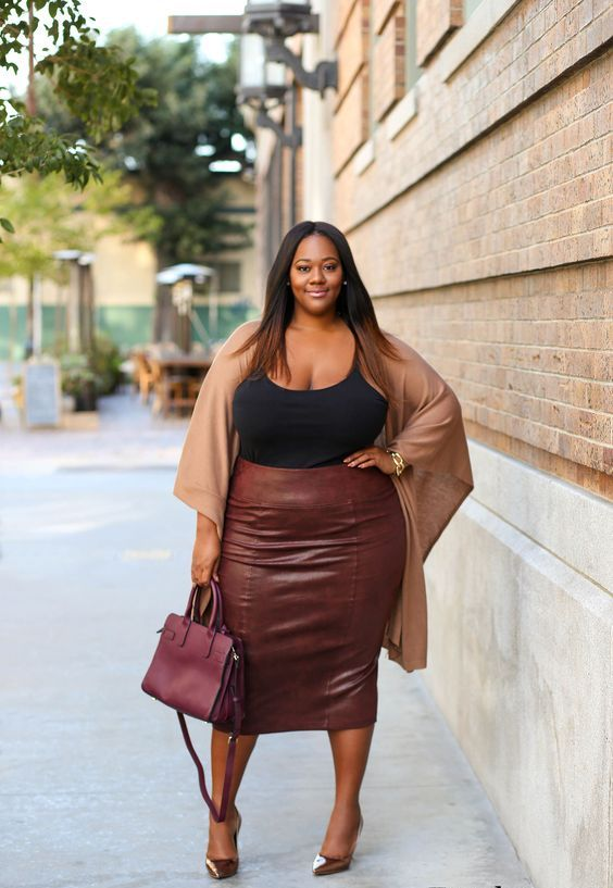 a black top, a brown leather midi pencil skirt, a tan coverup, metallic shoes and a plum bag for a wow effect
