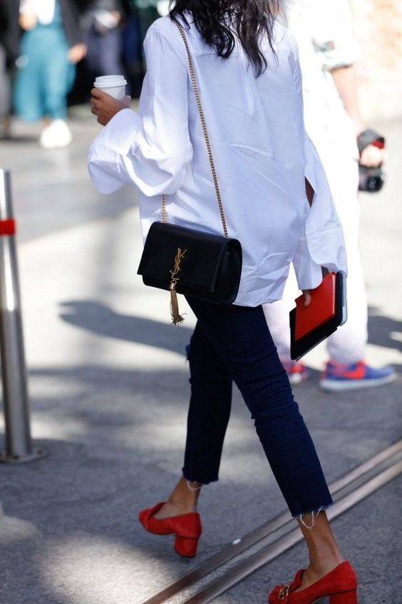 navy skinnies, an oversized white shirt, red suede shoes, a black bag