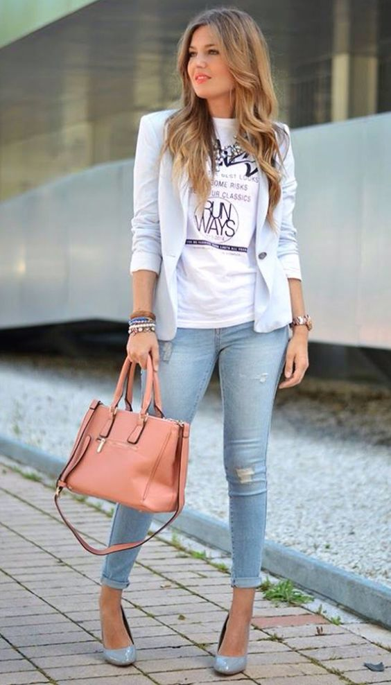 a powder blue jacket, a printed tee, blue ripped skinnies, powder blue shoes and a coral bag