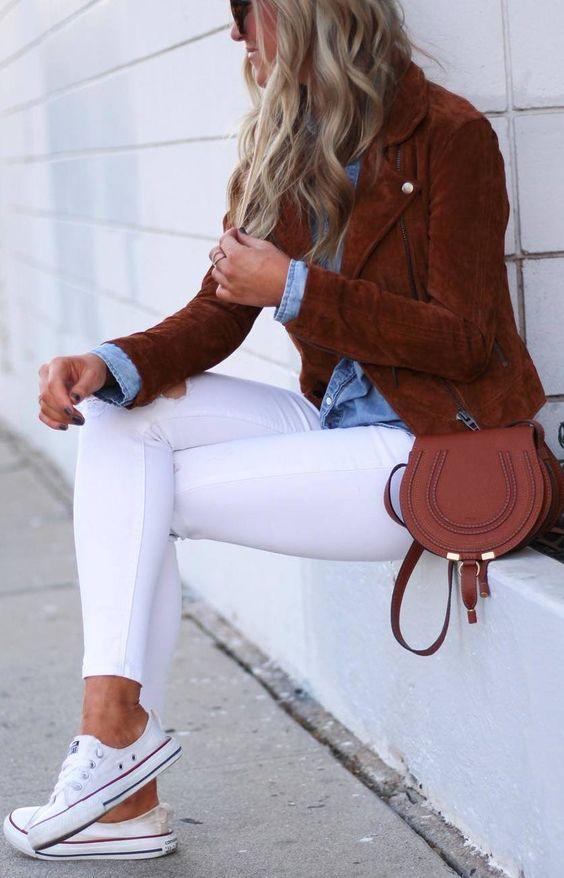 white skinnies, a chambray shirt, a rich brown suede jacket, a matching bag and white sneakers