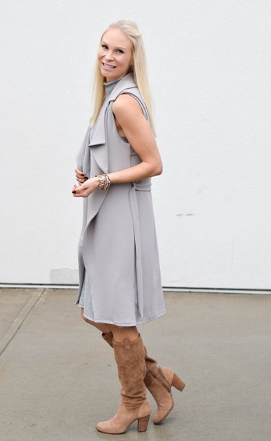 With gray dress and high boots
