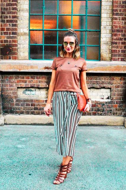 With bronze t-shirt, red clutch and brown sandals
