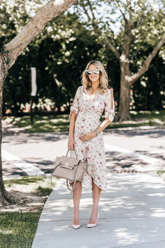 a gentle wrap floral dress with cutout sleeves on bows and blush heels