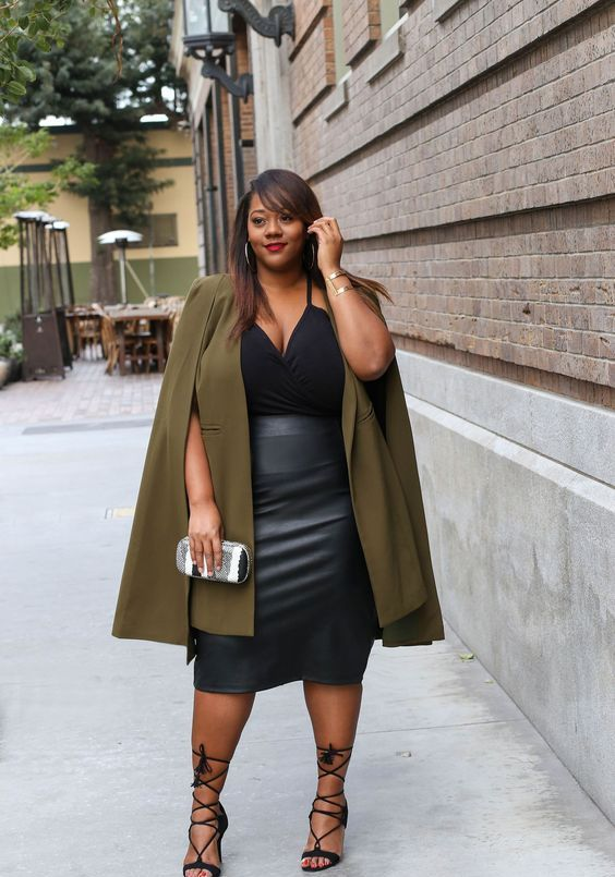 a black leather midi skirt, a black spaghetti strap top, black strappy heels and an army green trench