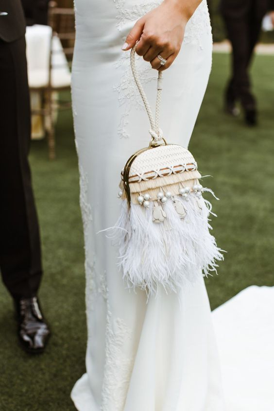 a super whimsy woven bridal clutch on a long loop, with fringe, pearls and leather cord detailing