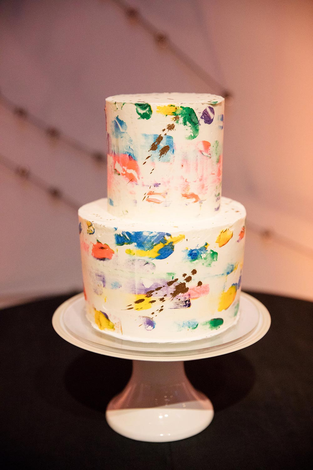 colorful paint-speckled wedding cake