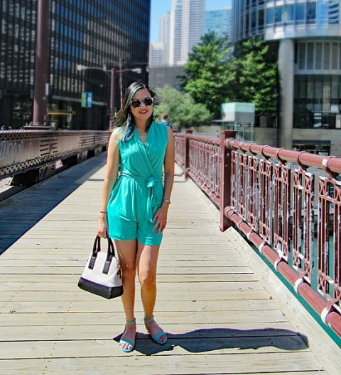 With black and white bag and turquoise flat sandals