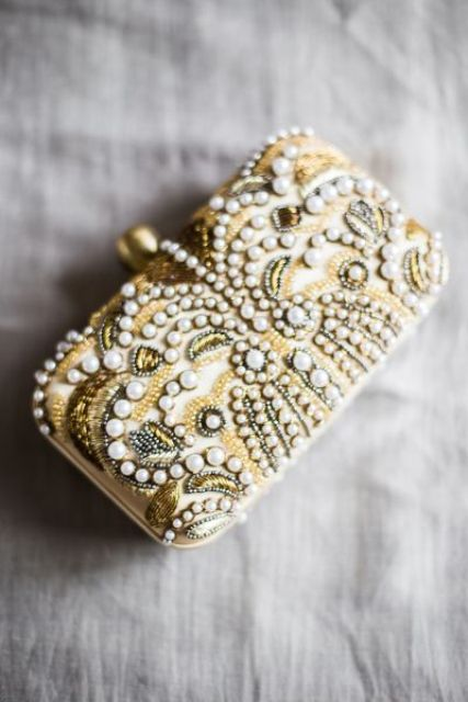a whimsy art deco inspired wedding clutch with gold beads, vintage detailing and pearls for a pretty touch