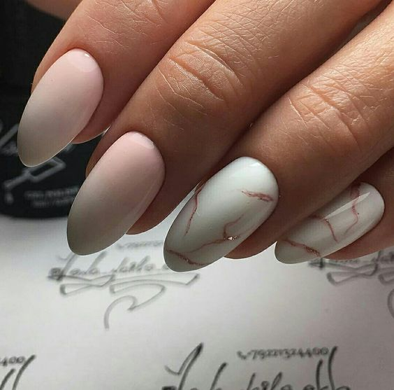 ombre pink nails plus two white with a rose gold marble effect ones for a romantic girl