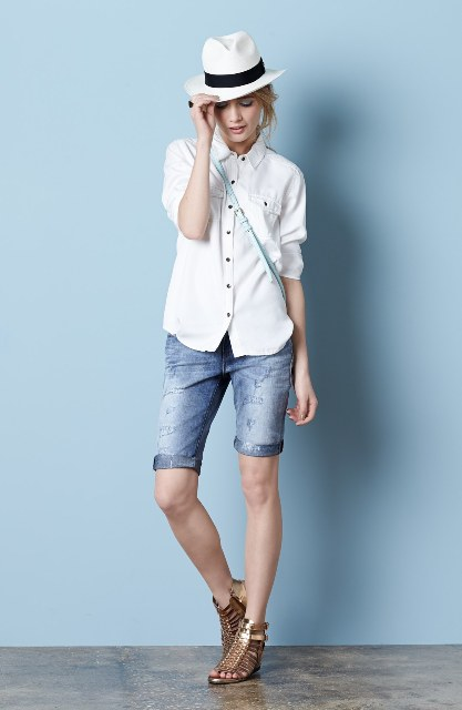 With white button down shirt, hat, crossbody bag and sandals