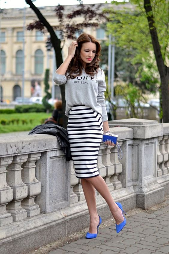 a grey printed sweatshirt, a striped pencil knee skirt and bold purple shoes for an accent
