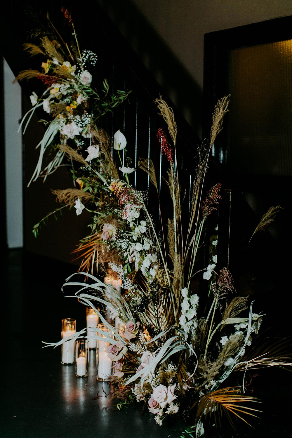 dry overgrown wedding flowers staircase installation