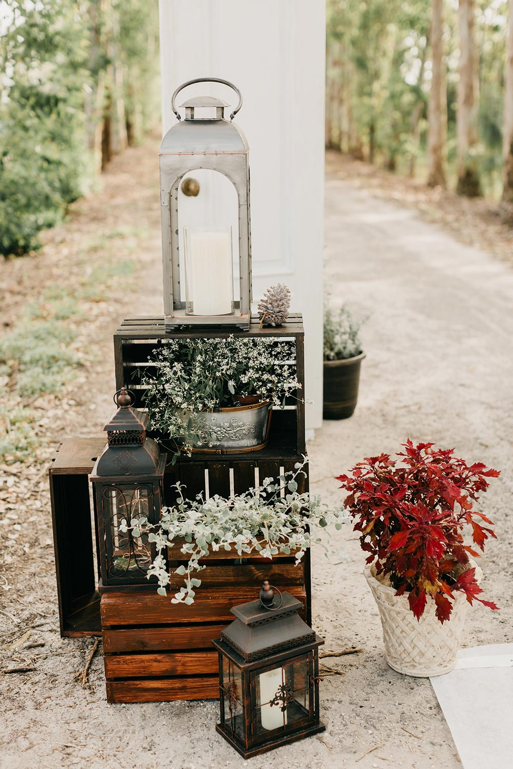rustic chic ceremony decor baby's breath and lanterns