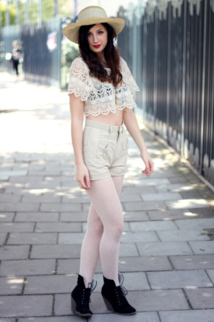 With beige shorts, white tights, black ankle boots and hat