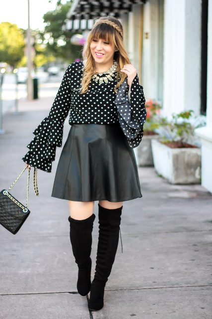 With leather skirt, over the knee boots and chain strap bag