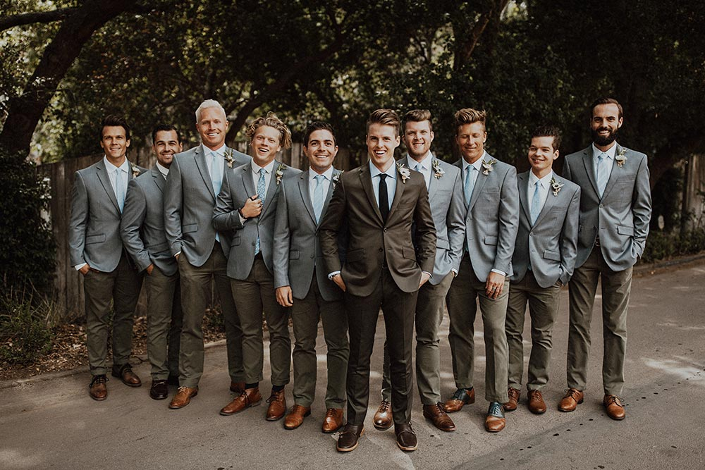 olive green groom suit and gray blue groomsmen suits
