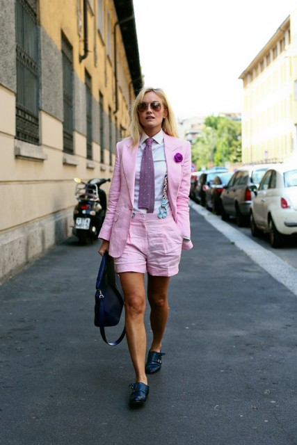 With white shirt, pink blazer, printed tie, black shoes and bag